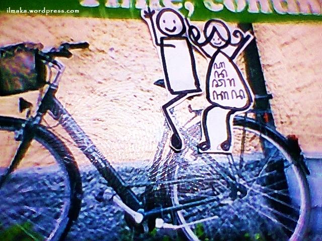 stickman cycling along